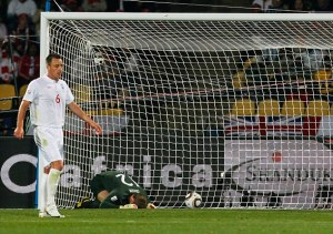 England goalkeeper Robert Green, center, reacts on the ground after United States' Clint Dempsey, not seen, scored a goal during the World Cup group C soccer match between England and the United States at Royal Bafokeng Stadium in Rustenburg, South Africa, on Saturday, June 12, 2010. (AP Photo/Eugene Hoshiko)