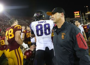 Southern California head coach Steve Sarkisian, former Washington coach, walks through players on his way off the field after the Huskies' win in Los Angeles at Memorial Coliseum on Thursday, Oct. 8, 2015. Washington beat Southern California 17-12, beating former coach Steve Sarkisian in their first meeting since his abrupt departure for the head coaching job at USC in late 2013. (Lindsey Wasson / The Seattle Times)