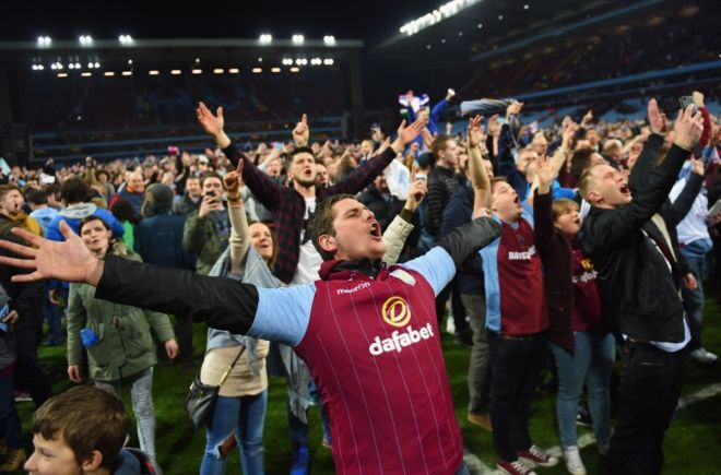 villa fans on pitch