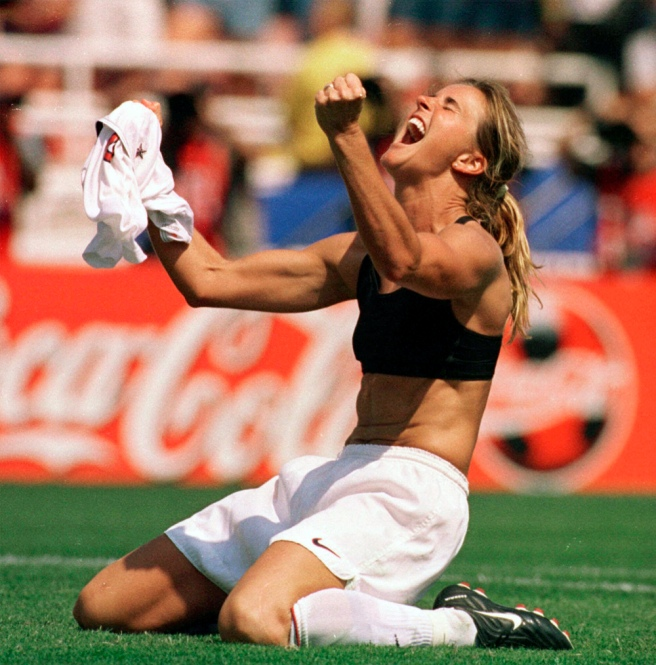 """FILE - In this July 10, 1999 file photo, the United States' Brandi Chastain celebrates by taking off her jersey after kicking in the game-winning penalty shootout goal against China in the Women's World Cup Final at the Rose Bowl in Pasadena, Calif. On Monday Aug. 19, 2013, Mia Hamm, Julie Foudy and Chastain visited a soccer camp in Manhattan and promoted """"The '99ers,"""" the latest in the ESPN Films Nine for IX documentary series that will air Tuesday night. (AP Photo/The San Francisco Examiner, Lacy Atkins, File) MANDATORY CREDIT. SAN FRANCISCO CHRONICLE OUT ORG XMIT: CAEXA301"""